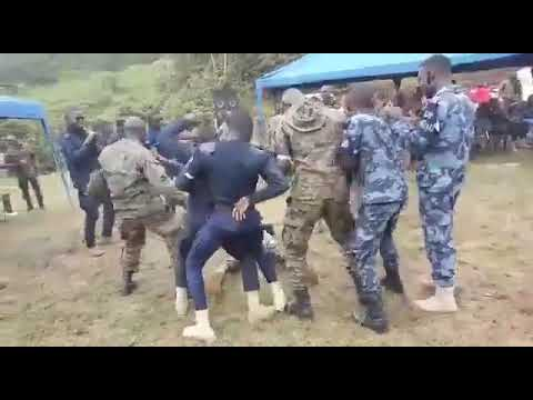 Ghana military personnel dance to one corner