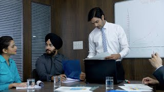 A team of a young businessman working and communicating together in an office - Sales meeting
