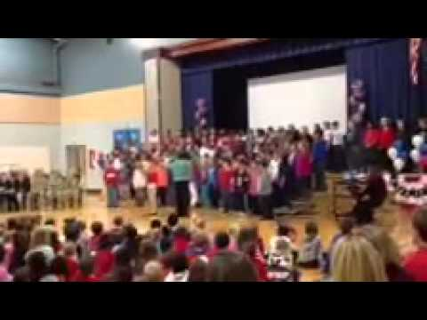Avery sings god bless America at shady grove school