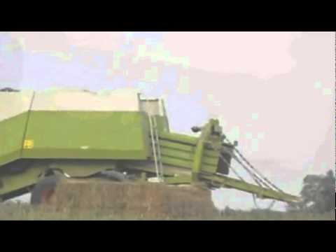 Farmer jumps into hay bale - machine! xD ^^