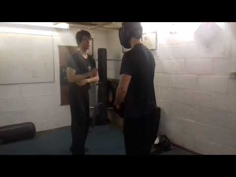 Eye jab to groin or knee attack
