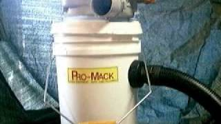 PROSPECTOR VACUUMS GOLD FROM THE CREVICE WITH A MACK VACK FROM PRO-MACK