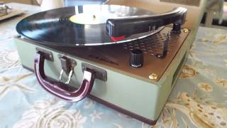 RCA record player, manual 3 speed playing a 33.3 RPM LP record