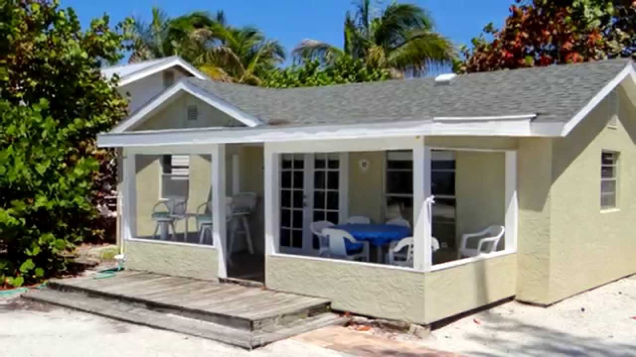 Beach Front Calypso Cottage With A Shared Heated Pool On
