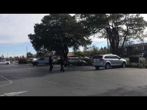 Security Guard Scraps With A Guy In Sacramento Parking Lot Scuffle