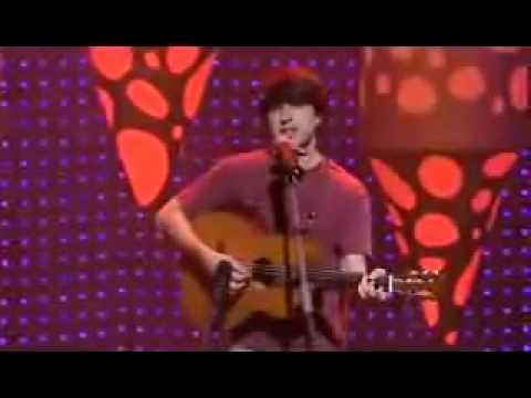 Demetri Martin jokes with guitar
