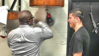 James Toney helping Ronald Gavril inside the Mayweather Boxing Club