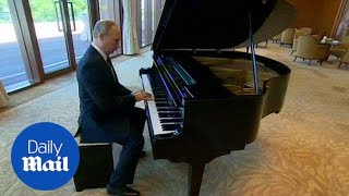 Putin on a show: Russian president shows off his piano skills - Daily Mail