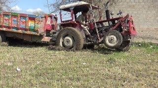 Massey Ferguson 240 Tractor in trouble has needed help form Massey 385