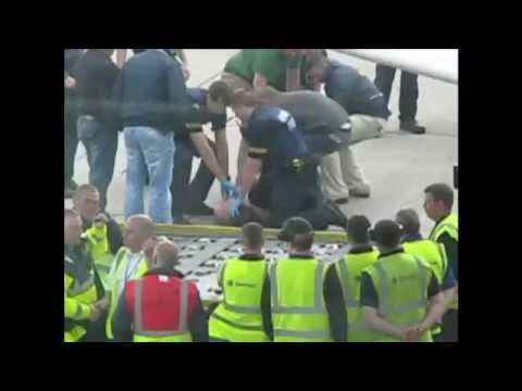 Cork Airport: Irish police chase lunatic, HD Funny Version (Benny Hill).