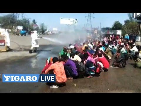 Coronavirus: les travailleurs migrants désinfectés au jet en Inde