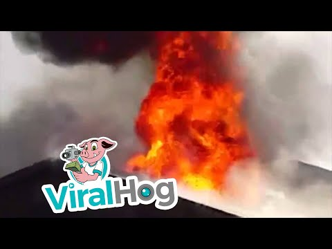 Firefighter falls through burning roof in Fresno CA || ViralHog