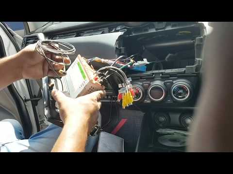 how to install music system in suzuki swift car