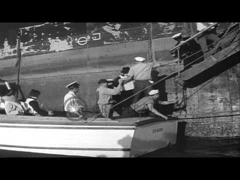 Coast guards move passengers of SS Manhattan luxury liner to tow the ship off a s...HD Stock Footage