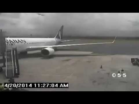 Stowaway Yahya Abdi exiting the wheel well at Maui Airport