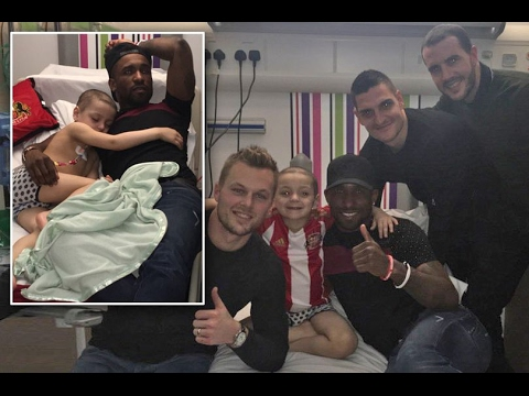 "Bradley Lowery cuddles up to ""best friend"" Jermain Defoe after cancer sufferer receives visit"