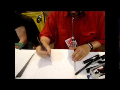 D'Israeli drawing Despair of the Endless at Birmingham Comic Con 2011