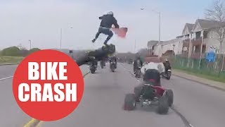 Moment motorcyclist is thrown 10ft into the air after failed wheelie