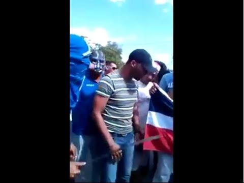 Dominicans stepping on the Haitian flag. Haitians vs Dominicans