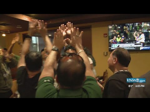 Fans cheer the 'Bows in Hawaii and Ohio as they capture the national title