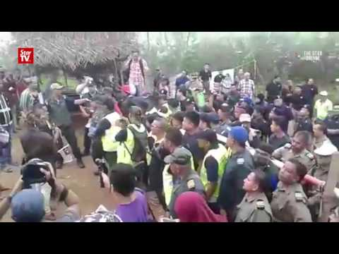 Orang asli sing national anthem during blockade operation