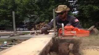 Milling lumber from pine logs on the homestead with an Alaskan chain saw mill and a Husqvarna 372xp