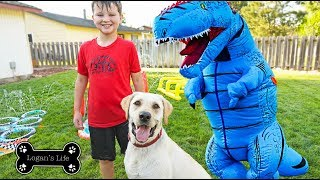 Logan Plays in Water With Blue T - Rex and Carter