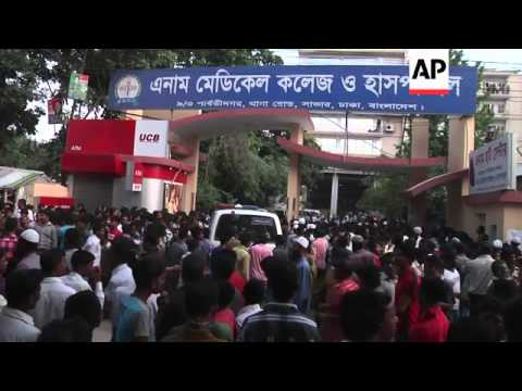 Death toll continues to rise after Bangladesh garment factory collapse