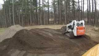Compact Track Loader Spreading Loam