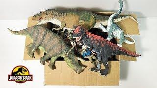 a-box-of-vintage-jurassic-park-toys-t-rex-spinosaurus-carnotaurus