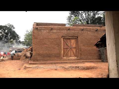 Man constructing traditional mud house in Narna village, Madhya Pradesh