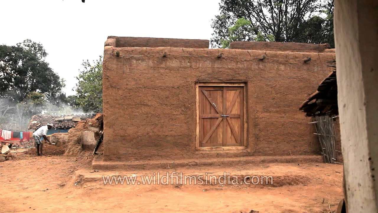 Man Constructing Traditional Mud House In Narna Village