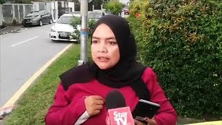 Police truck leaves Najib's house with documents; woman defends Ex-PM