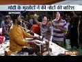 Gujarat: Men wearing PM Modi masks shower currency notes on 'bhajan' singers