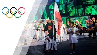Former paralympic archer Zahra Nemati carries Iranian flag