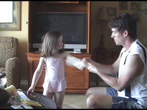 Shady Day Sunscreen wipes make little beach girl happy. thumbnail