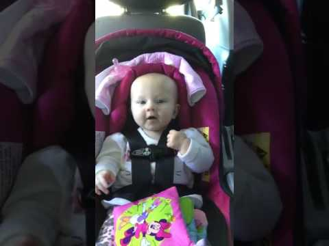 Baby dancing in the car -