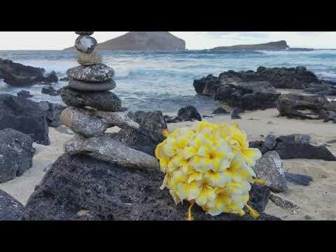 Yellow plumeria bouquet with Hibiscus @ wedding in Hawaii