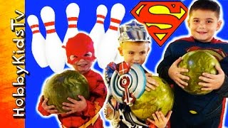 Superheroes Go Bowling! Superman, Flash + Optimus Prime Candy Surprise HobbyKidsTV