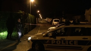 Raw: Police Raid Home After Paris Shooting