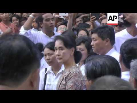 Suu Kyi attends funeral of veteran dissident and democracy campaigner