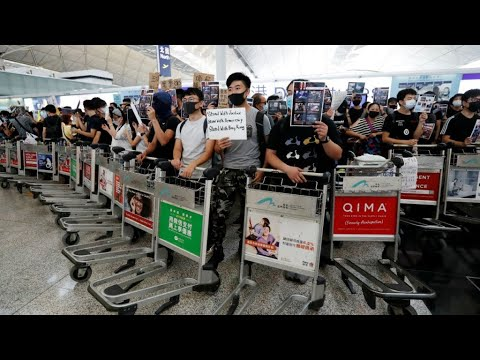 hong-kong-protesters-stage-new-airport-rally-hours-after-flights-resume