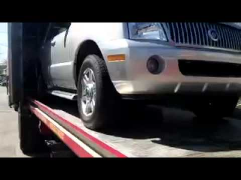 Loading and shipping a car into a container going overseas.