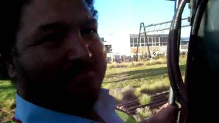 piloting a steam locomotive out of cape town station south africa 01