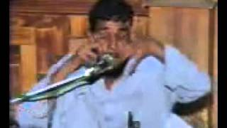 poor blind pakistani guy sing indian song like kumar sanu awasom..flv