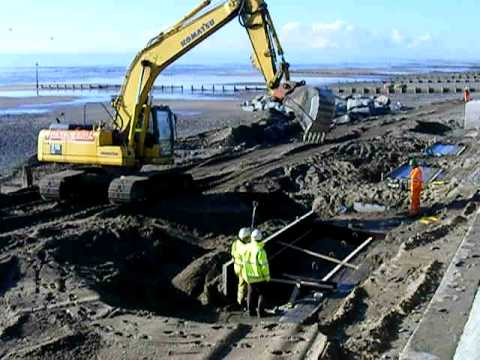 Pouring concrete on Tywyn Sea Defence Scheme.