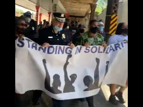 Police brutality protesters march with officials in New Jersey