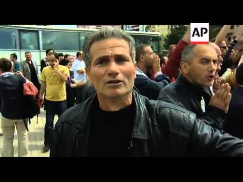 Police fire tear gas to disperse ethnic Albanians protesting Serb official's visit