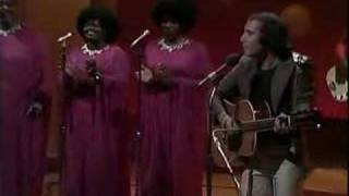 LOVES ME LIKE A ROCK by Paul Simon & The Jesse Dixon Singers