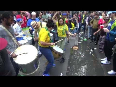 BRAZILIAN SAMBA SCHOOL ORCHESTRA PLAYS BRAZILIAN FESTIVE SAMBA MUSIC IN THE STREET